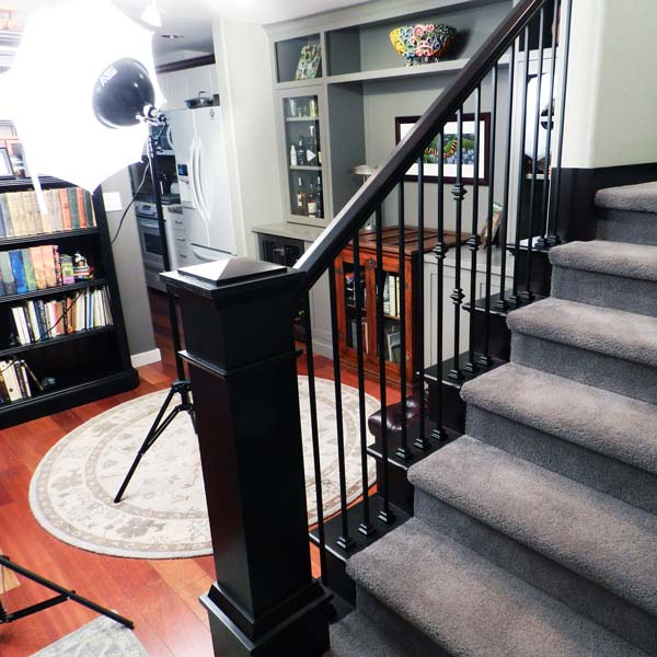 Dark staircase with grey carpet