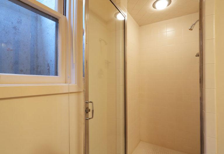 White tiles inside of bathroom shower
