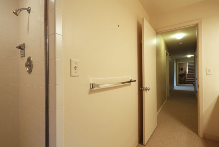 White opened bathroom doors next to the hallway