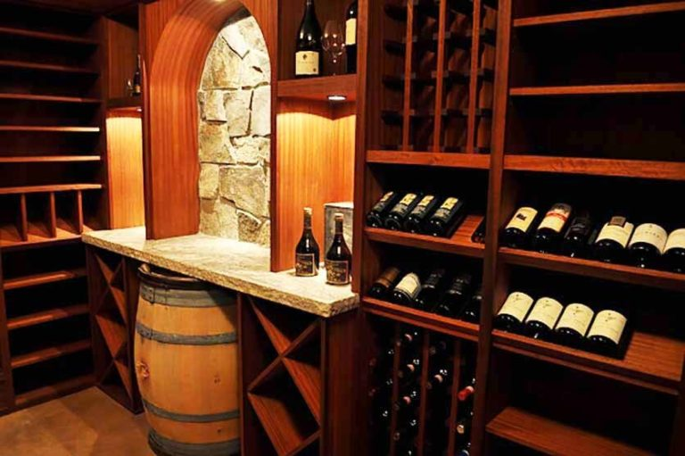 Wooden wine cellar with marble countertop inside of the bathroom
