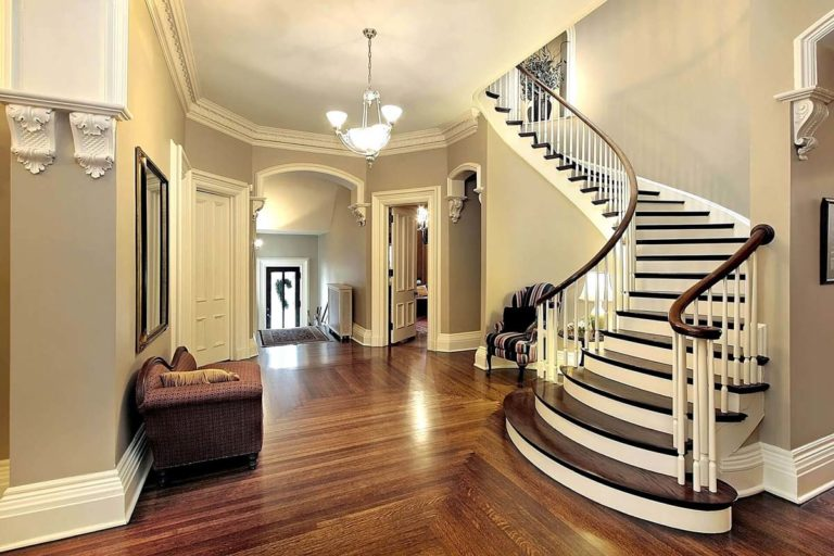 White staircase inside of the hallway