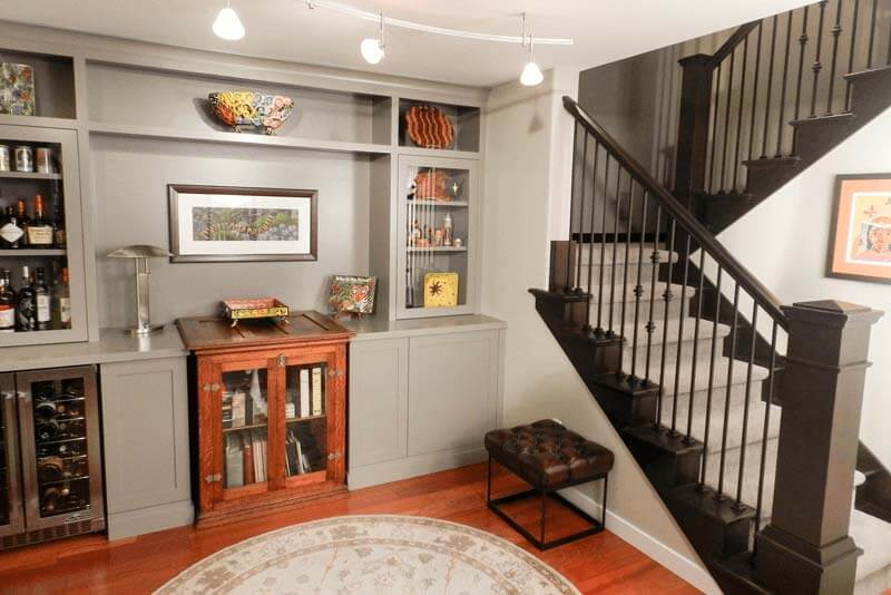 Dark staircase next to the living room cabinets