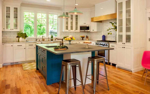 Spacious kitchen with blue cabinets in center