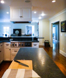 White hanging kitchen cabinet above marble countertop