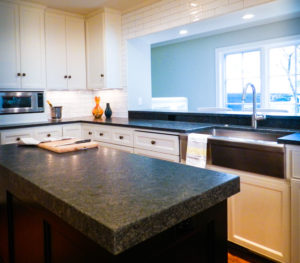 Dark marble countertop inside of the kitchen