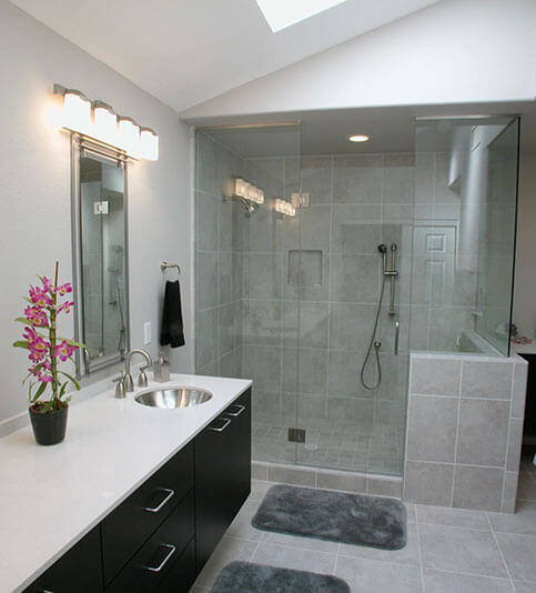 Bathroom shower with glass panel