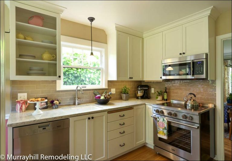 White kitchen cabinets with marble countertop