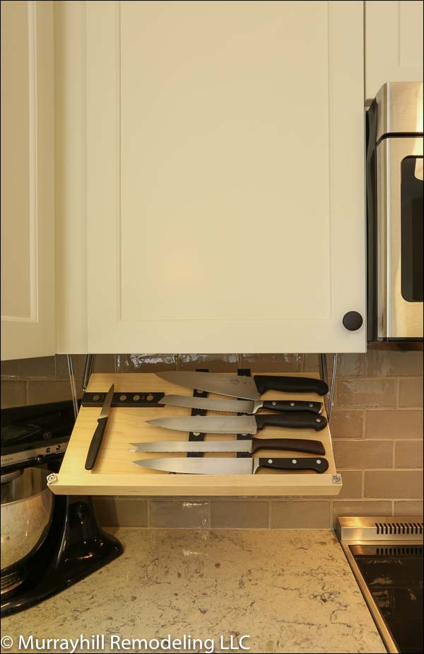 A direct view of the pull-down knife holder that hangs from the bottom of the upper cabinet which can be closed to be hidden out of view.