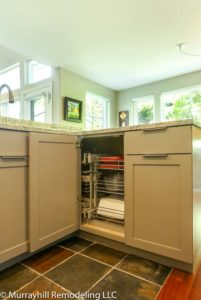 Opened white cabinets inside of the kitchen