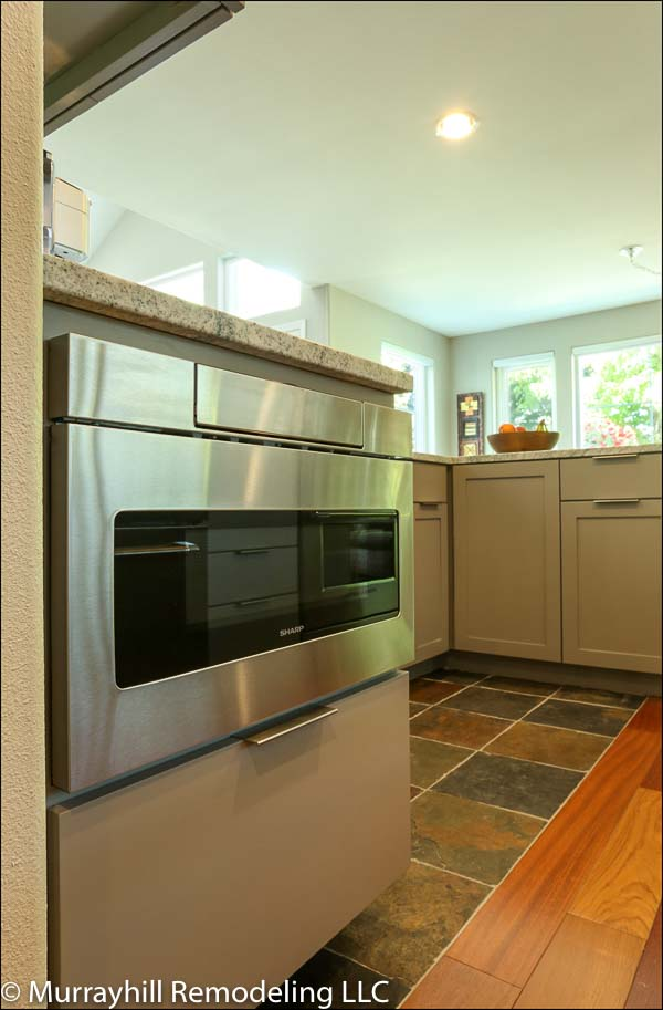 Stainless steel oven inside of the kitchen