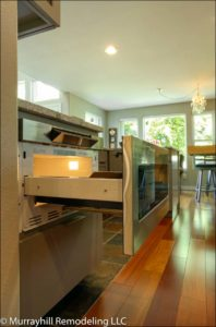 Opened oven inside of the kitchen
