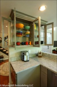 Open kitchen cabinets with glass doors