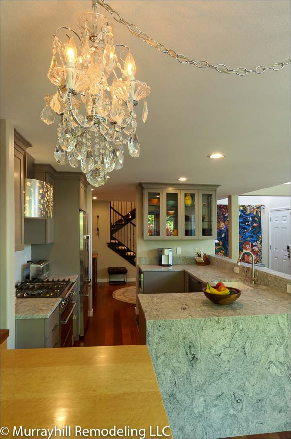 Chandelier inside of the kitchen with marble countertop