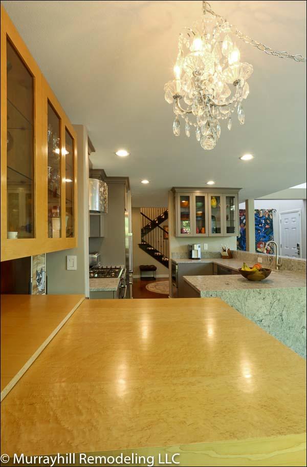 Chandelier above kitchen