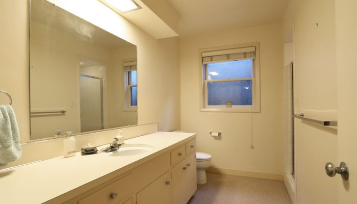 White cabinets inside of the bathroom